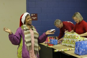 ECS Headmaster Bryan Miller wraps presents for one of our MAM moms whose children actively participate in our programs