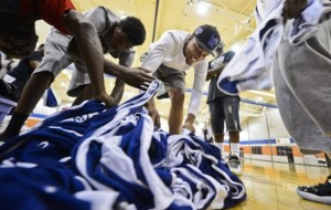 Michael Matlock, (center) 20, from Memphis, searches through the jerseys to find his number as midnight basketball tournaments are being held by the Grizzlies at the Memphis Athletic Ministries Grizzlies Athletic Center in an attempt to lower crime among teenagers. Over 80 participants signed up for the league that will make up over a dozen teams. (Chris Desmond/Special to The Commercial Appeal)