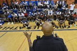 Memphis police officer John Grandberry speaks to the participants before the midnight basketball tournaments begin. The league is being held by the Grizzlies at the Memphis Athletic Ministries Grizzlies Athletic Center in an attempt to lower crime among teenagers. (Chris Desmond/Special to The Commercial Appeal)