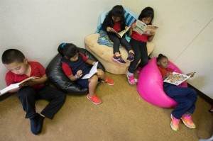 Students, from left, Abimael Rodas-Cortez, Leidy Hernandez, Kandi Hernandez, Maria Hernandez and Kiara Smith read during a session of MAM's Academic Program. (Daily News/Andrew J. Breig)