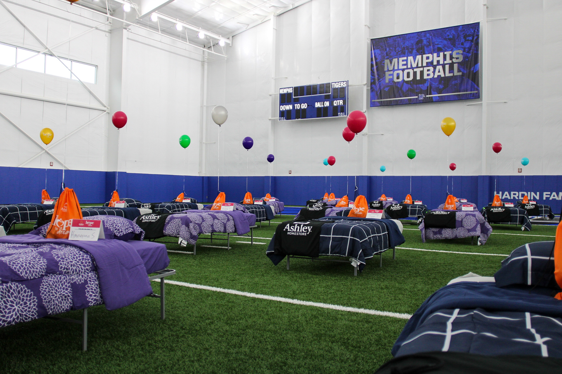 Kids get time with Tigers football players, and receive restful gifts